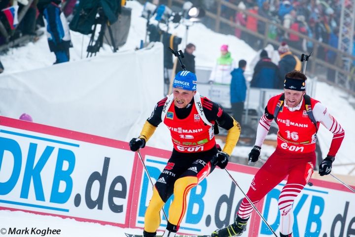 12/16/2012 Pokljuka, Slovenia. Erik Lesser of German leads Simon Eder of Austria in the 15 kilometre mass start race of the Biathlon World Cup race in Slovenian Pokljuka.