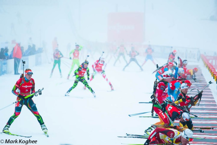 Women biathletes come out of the fog to shoot in the women's race of the biathlon world cup in Pokljuka.