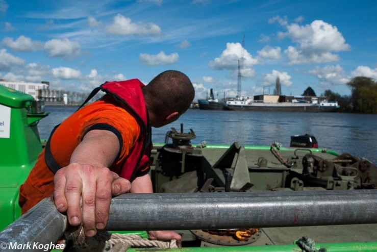 April 11. Social return on investment in practise. A young worker on a boat in Koog aan de Zaan, who requested to be anonymous, got a job because the city forced a contracter to hire an unemployed to get the contract for dredging works on a river.