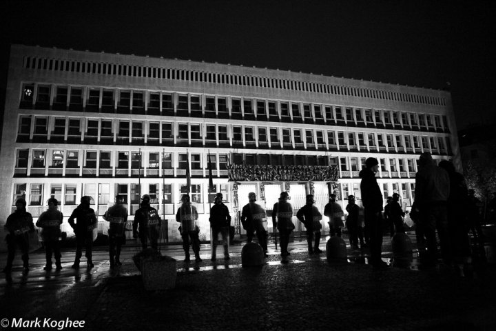 In fall a series of violent protests spread through Slovenia. Here riot police stands guard in front of the Parliament on November 27.