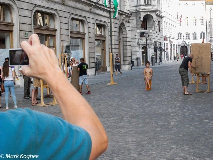 In Ljubljana anything can happen. A lady poses naked for an art class in the centre of town on August 21.