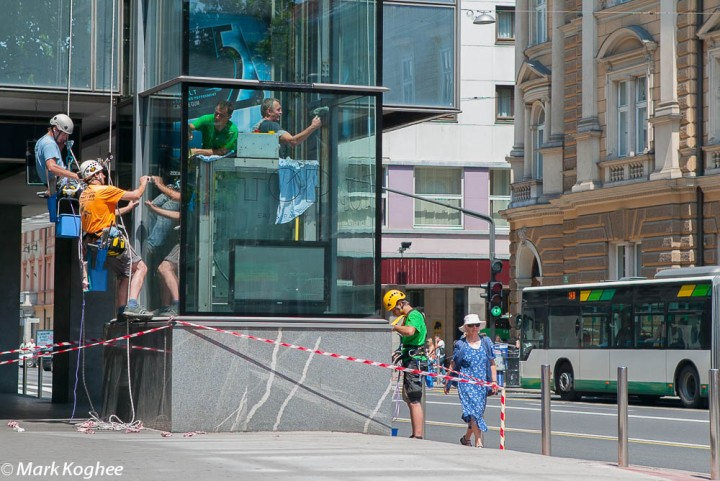 Windowwipers clean a glass tower on Slovenska Cesta in  Ljubljana on June 20.  They don't use scaffolding or ladders but a solid rope-access.
