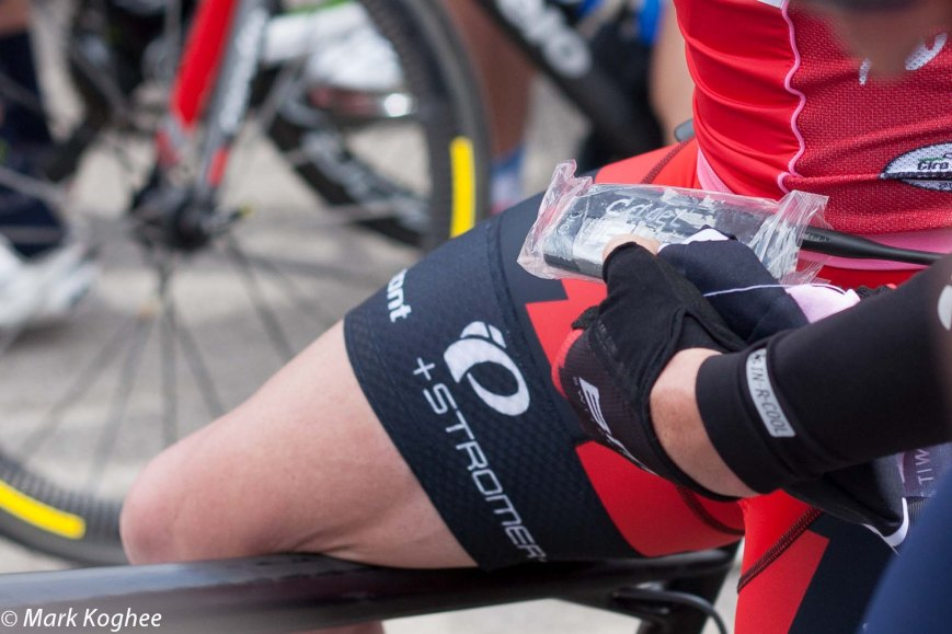 Cadel Evans struggled with his radio before the start of stage 11.
