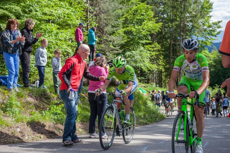 Marco Canola, on the right, does a ´Froomy´and looks at his stem. Canola won stage 13. Today he finished 132th.