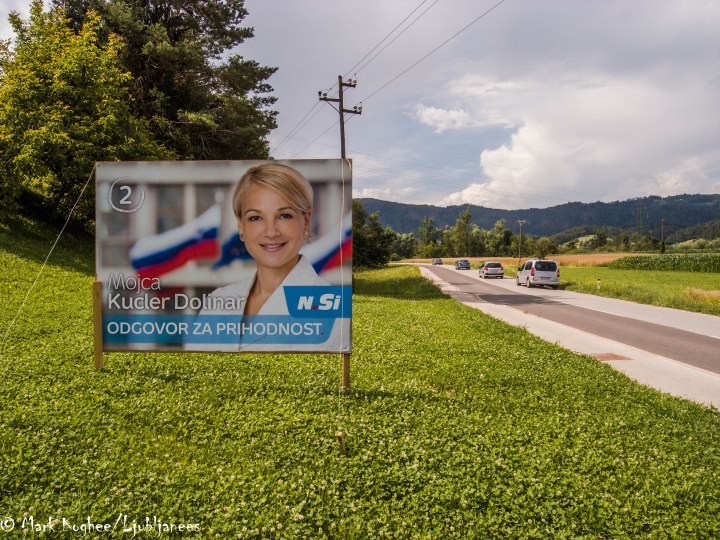 Mojca Kucler Dolinar is a Slovenian politician. And she was standing along the road in Dobrava. She's currently a member of the Municipal Council of Ljubljana for her party New Slovenia.