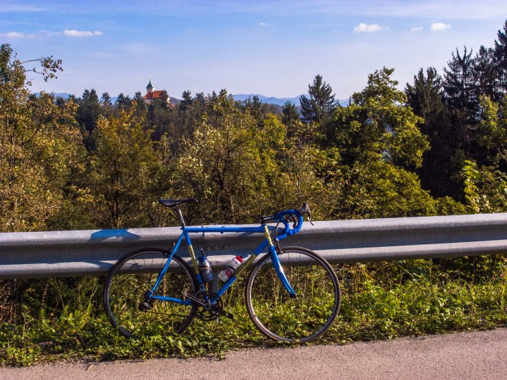 The Saint Ulrich church lies at and altitude of 428 metres 80 metres above the village of Zaklanec. The racebike is mine.
