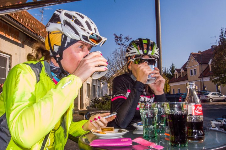 It is scientifically  proven that bicycle helmets reduce the risk of head injury. There is no proven benefit at all of wearing a bicycle helmet while drinking coffee.